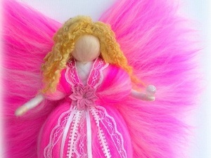 Bright pink felted fairy