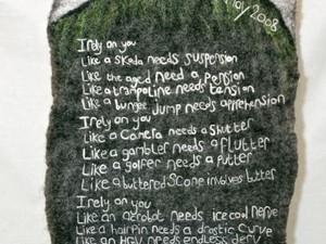 Poem on the hill created using felt