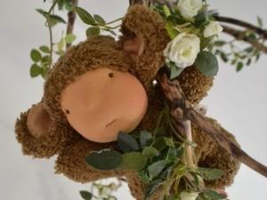 Felt monkey doll hanging in tree