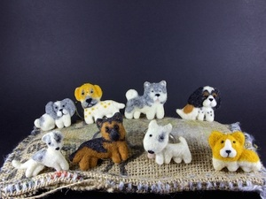 Selection of felted dogs on hessian
