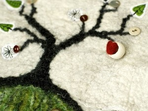 3D tree on the hill made out of felt