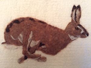 A Running Hare Made Using Merino Wool