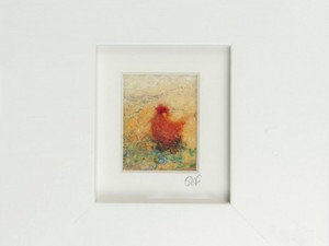 Red hen in frame made out of felt