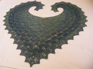 Heart shaped green yarn rug