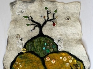 Tree on the hills made out of felt material