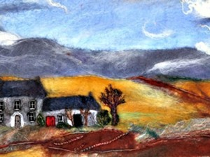 Felted house in the sunset