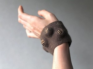 Brown wrist bracelet created using felt