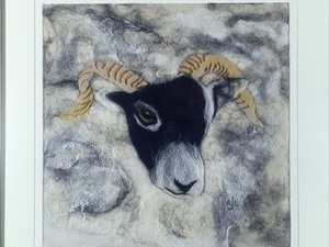 Rams head on white felted background