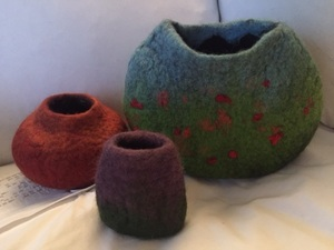 A Group Of Vases Made With Merino Wool