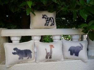 Felted animal cushions