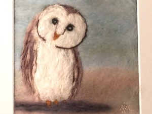 Close up of brown and white felted owl