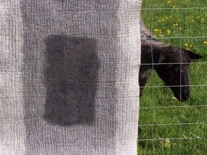 Grey and white felted throw
