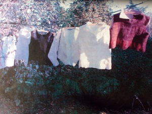 Selection of felted clothes on washing line