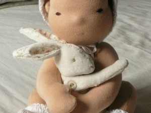 Baby doll and rabbit made out of felt